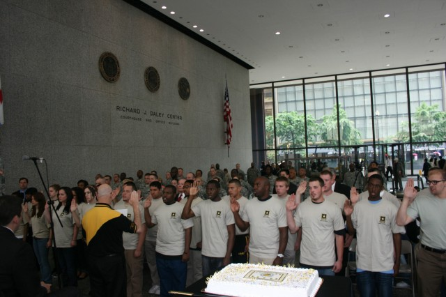 Medal of Honor recipient Mr. Allen J. Lynch conducts a future Soldier swear in ceremony with new recruits during the Army Birthday Celebration in Daley Center, Chicago, June 11, 2009.