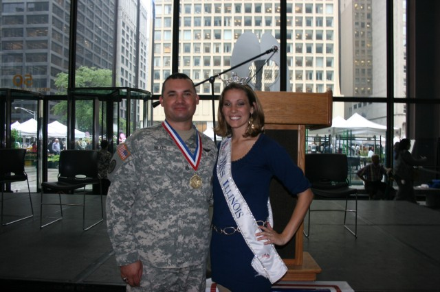 Ms. Katie Lorenz, Miss Illinois and Staff Sgt. John Reyes following the Army Birthday Celebration in Daley Center, Chicago, June 11, 2009.  SSG Reyes was presented with the Morrell Award during the ceremony by Medal of honor Recipient Mr. Allen J. Lynch.