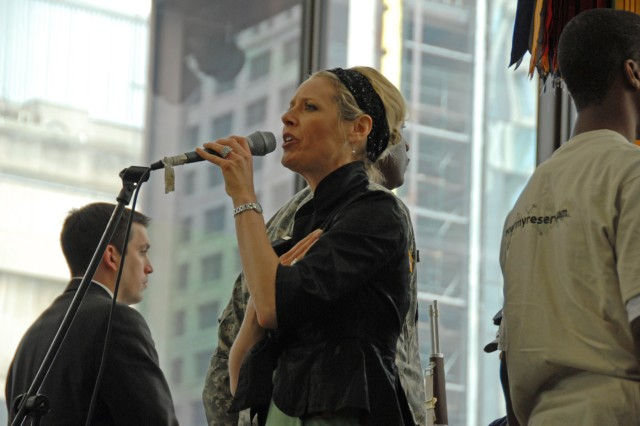 Ms. Alison Ruble, USO of Illinois performs the National Anthem during the Army Birthday Celebration in Daley Center, Chicago, June 11, 2009.