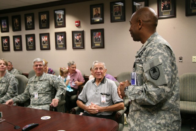 Col. Kendal Cunningham, chief of staff, U.S. Army Space and Missile Defense Command/Army Forces Strategic Command speaks to Wounded Warriors in a meeting before the Army Birthday celebration here June 11.