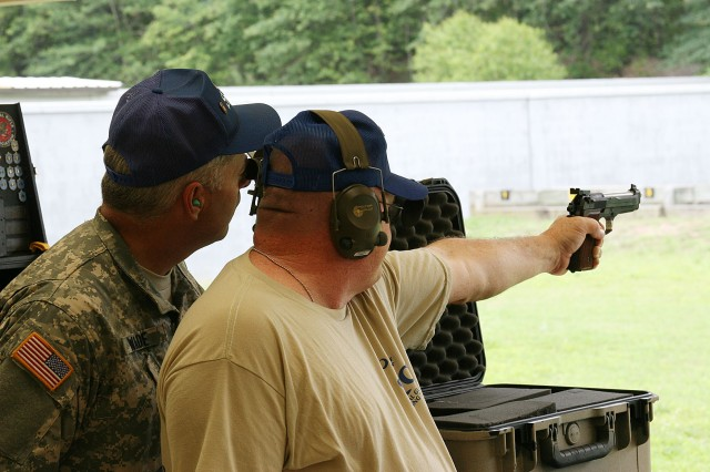 Staff Sgt. Nathan Wade, South Carolina National Guard, coaches Sgt. 1st Class Mitch Henson, SCNG, during the 50th Interservice Pistol championships at Fort Benning June 8-12. More than 75 competitors and 14 teams participated in the annual event.