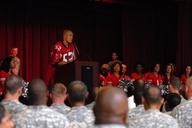 Coy Wire, a safety for the Atlanta Falcons talks to the Soldiers assigned to the 3rd Heavy Brigade Combat Team, 3rd Infantry Division, before a meet-and-greet at the Kelley Hill Recreation Center on Fort Benning, Ga., June 8. Ten Atlanta Falcon players and 10 cheerleaders from the Falcon's dance team traveled to Fort Benning to talk with the Soldier's of the 3rd HBCT and sign autographs.