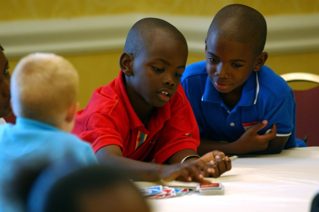 Army Reserve children play UNO at the Omni Resort at Champions Gate while their parents attend the 81st Regional Support Command's Yellow Ribbon Reintegration Program held near Orlando, Fla., June 12-14. More than 200 Soldiers and their families attended the three-day workshop to learn about resources to help them reintegrate back into their communities.