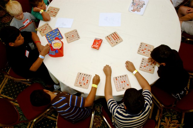 Army Reserve children play a game of bingo at the Omni Resort at Champions Gate while their parents attend the 81st Regional Support Command's Yellow Ribbon Reintegration Program held near Orlando, Fla., June 12-14. More than 200 Soldiers and their families attended the three-day workshop to learn about resources to help them reintegrate back into their communities.