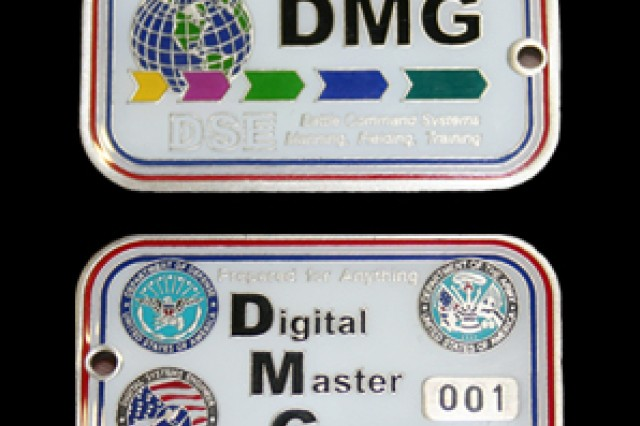 Frank Connolly, Regional Lead Digital Systems Engineer for the 407th AFSB CONUS West, was presented with the first minted digital master gunner (DMG) coin in honor of becoming the first person to achieve DMG certification.