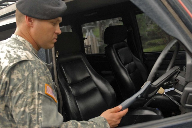 Staff Sgt. Mark Newgent, a native of Pearl City, Hawaii and force protection specialist assigned to the 9th Mission Support Command checks for explosives residue in a vehicle at a hotel in Bandung, Indonesia, June 12.