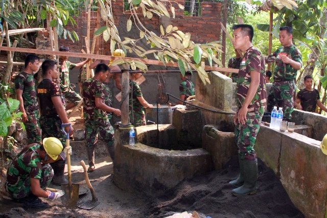 Tentara Nasional Indonesia - Angkatan Darat, or Indonesian Army, engineers work on a public toilet structure in Bandung, Indonesia, approximately 80 miles east of Jakarta, June 15. The structure is one of two Humanitarian and Civic Assistance projects which will be completed during Exercise Garuda Shield 09. GS09 is the latest in a continuing series of exercises designed to promote regional peace and security. Training will focus on peace support operations and Global Peace Operations Initiative certification, a Command Post Exercise, a Field Training exercise and Humanitarian and Civic Assistance projects.