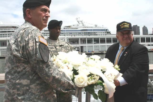 Army Vice Chief of Staff Gen. Peter W. Chiarelli (left) and Patrick Gualtieri (right), executive director, United War Veterans Council, prepare to lay a wreath in honor of all fallen Soldiers during an Army Birthday celebration at the USS Intrepid in New York City, June 14.