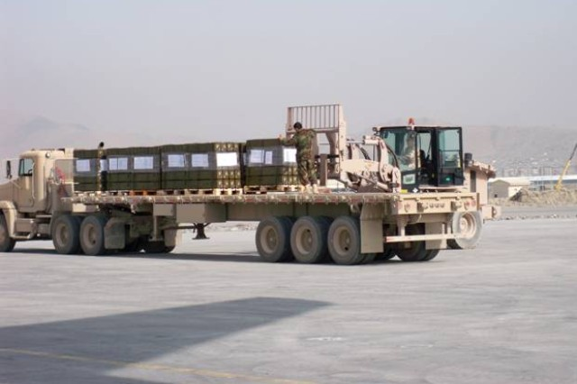 Urgently needed 57mm aviation rockets are off-loaded at Kabul International Airport, Afghanistan.