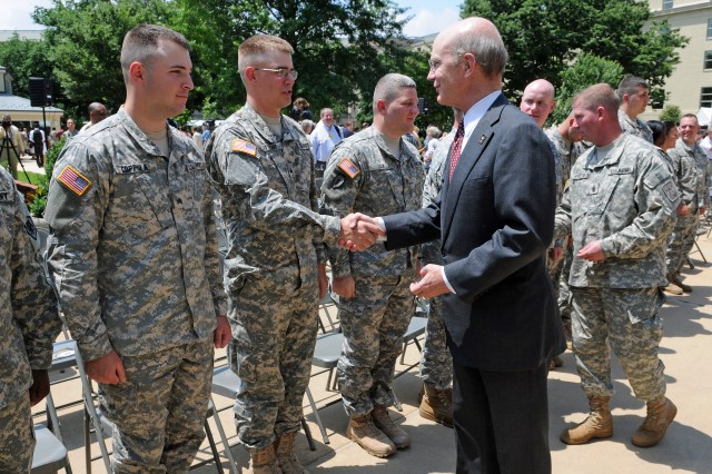 Secretary of the Army Pete Geren and Sgt. Maj. Kenneth O. Preston congratulate new members of the noncommissioned officers corps during the Army's 234th birthday celebration at the Pentagon June 12.