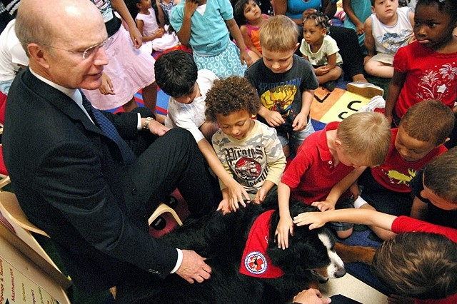 As part of the Army birthday, Army Secretary Pete Geren introduces Cordymay, a certified pet therapy dog from Walter Reed Army Medical Center, to children at Fort Myer's Cody Child Development Center. The dog is featured in the birthday book that Geren read to children there, June 15.