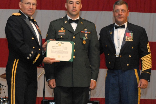 Lt. Gen. Benjamin R. Mixon, commanding general, USARPAC and Command Sgt. Maj. Joseph P. Zettlemoyer, command sergeant major, USARPAC, present Spc. Matthew Grothe with the Army Commendation Medal after winning the Soldier of the Year Competition during the U.S Army's 234th birthday celebration at the Hilton Hawaiian Village June 13.