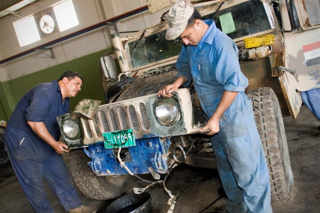 Iraqi mechanic replace the grill  on an armored humvee at the Third-Line Maintenance Facility at Camp Taji, Iraq May 28.  The Iraqi Security Forces section of the 10th Sustainment Brigade said it has moved away from it's role as trainers to the Iraqi Army units it is partnered with and is now in the advising stage of its mission