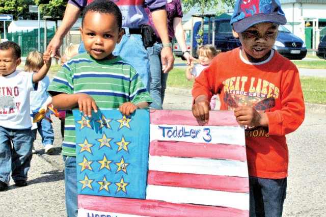 Eric Graham (left) and Ehlija McKain march in the Wiesbaden Child Development Center's Army Birthday Parade on Wiesbaden Army Airfield June 12.
