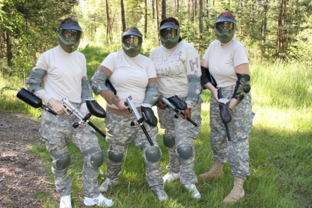 Spouses from 172nd In. Bde. gather June 3 to compete in the Spouses' Shootout Challenge, completing marksmanship simulations, a road march and a paintball course.