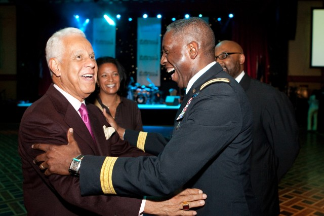 Gen. William E. Ward, commander of U.S. Africa Command (right), embraces L. Douglas Wilder, former governor of Virginia and the first African-American elected to state office, after Ward received a Lifetime Leadership Award during a gala for the 100 Black Men of America on June 13, 2009. Ward is the only active-duty, four-star African-American general and is only the fifth African-American to achieve this rank.