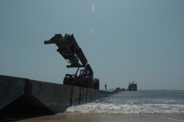 """An ATLAS truck reaches Onslow Beach at Camp Lejeune, N.C., during Joint Logistics Over the Shore (JLOTS) 2009, an annual joint training exercise in which ships are loaded and unloaded without the benefit of deep draft-capable, fixed port facilities."""""""