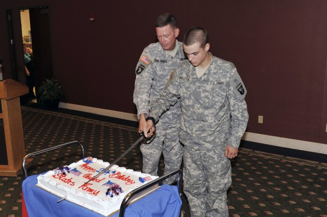 Maj. Gen. Jeffrey Schloesser, commanding general Fort Campbell and 101st Airborne Division, and Pvt. Jesse Appleton, 3rd Brigade Combat Team, 101st Airborne Division, take part in the annual cake cutting ceremony Friday celebrating the U.S. Army's 234th birthday at Cole Park Commons, Fort Campbell. Appleton is the youngest Soldier at Fort Campbell.