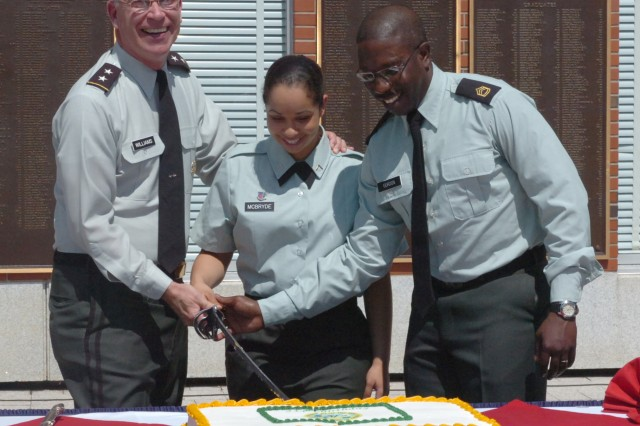 Maj. Gen. Robert Williams, U.S. Army War College Commandant, was assisted in cutting the birthday cake by Pvt. 2nd Class Alissa McBryde and Sgt. 1st Class Ronald Gordon during the USAWC's 234th Army Birthday Celebration June 15. McBryde, a food inspector at Carlisle Barracks, is the youngest Soldier on the installation. Gordon, a part of the Center for Strategic Leadership, was recently promoted to Sgt. 1st Class.