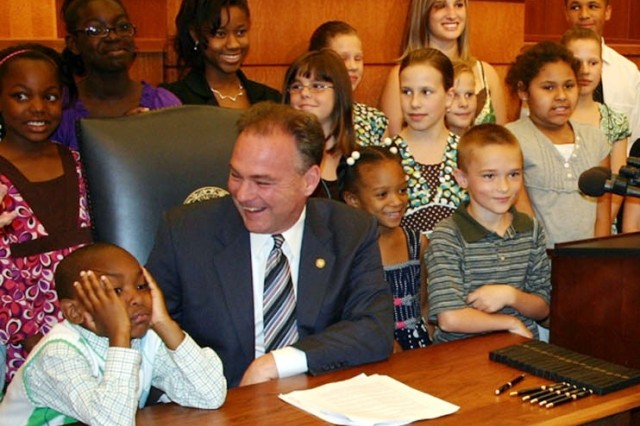 Virginia Gov. Tim Kaine shares a laugh with Army children at the ceremonial signing of the Interstate Compact on Educational Opportunities for Military Children at the Virginia State Capitol building, June 16. According to Gov. Kaine's office, Virginia is home to 76,352 school-aged children of active-duty military, more than any other state in the nation.