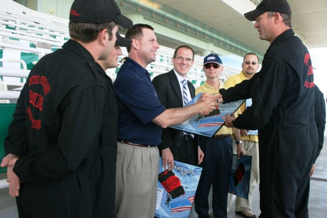"Sgt. 1st Class, Dave Rose, Team Leader, USASOC 'Black Daggers' Parachute Demonstration Team, Fort Bragg, NC, and his teammates, present Tony Enrietto, President, USO of IL, their team lithograph after the paratroopers jumped into Arlington Park. Also presented with team plaques, from left to right are: Wesley Ward, Mgr, of Marketing and Advertising for Arlington Park; Ross Docksey, Chairman, USO of IL and Geoff Gephart, USO Project Officer for the ""Salute to the Troops"" Day, on Sunday, 14 June in Arlington Heights, IL. The event honoring our military was co-hosted by Arlington Park and the USO of IL."
