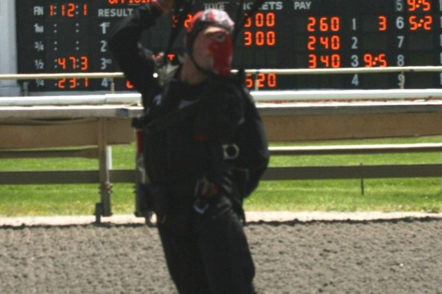 "Sgt. Tony Galusha, USASOC \'Black Daggers,"" lands dead-center on the target, during the Arlington Park Racecourse and USO of IL, ""Salute to the Troops"" Day at the racetrack, Arlington Heights, IL."