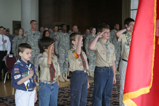 "Boy Scouts and a lone Cub Scout lead the audience in the ""Pledge of Allegiance"" during the Army Birthday ceremony at the West Point Club on June 16.  The West Point ceremony included a symbolic placement of the campaign streamers on the Army Flag, patriotic tributes, a re-enlistment and a promotion.  (Photo by Master Sgt. Dean Welch/DComm)"