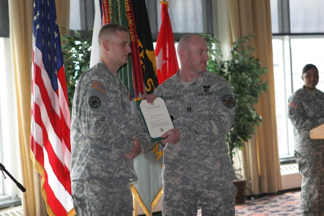 Sergeant Steven Christiansen, left, holds his promotion certificate along with Capt. Jamie Bazdaric following Christiansen's promotion during the Army Birthday ceremony on June 16.  The promotion was part of West Point's Army Birthday ceremony.  (Photo by Sgt. Vincent Fusco/DComm)
