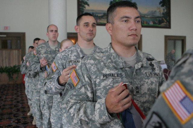 Master Sgt. Santiago Perales, along with six other Soldiers, holds campaign streamers before placing them on the Army Flag during the Army Birthday ceremony at West Point, June 16.  The ceremony, held in the West Point Club ballroom, marked the Army's 234 years with the symbolic placement of the streamers, a re-enlistment, a promotion and patriotic music involving the West Point community.  (Photo by Master Sgt. Dean Welch/DComm)