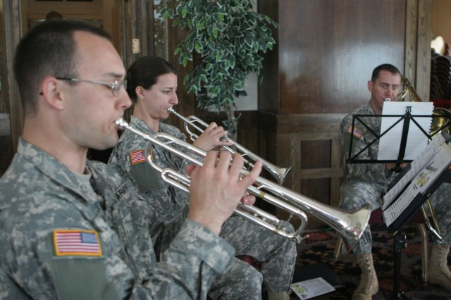 Soldiers of the West Point Band play music before the start of the Army Birthday ceremony at the West Point Club on June 16.  The West Point community marked the Army's 234th birthday with a ceremony that included a symbolic placement of the campaign streamers on the Army Flag, a re-enlistment and a promotion.  (Photo by Master Sgt. Dean Welch/DComm)