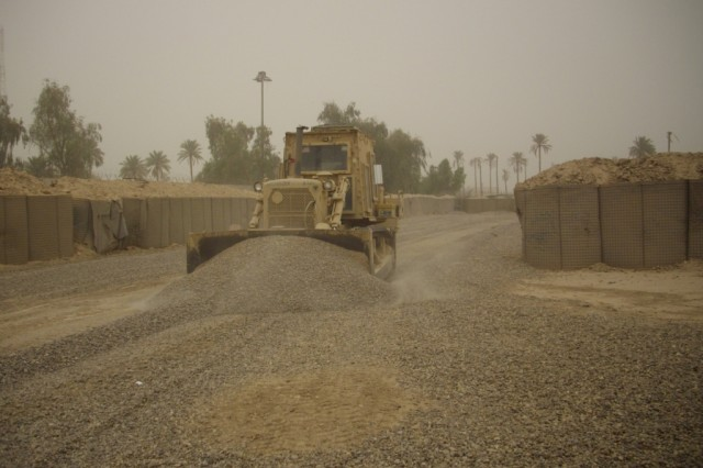 BAGHDAD - A heavy equipment operator, Equipment Platoon, 46th Engineer Combat Battalion (Heavy), 225th Engineer Brigade, uses a bulldozer to redistribute and level gravel around the ranges at Forward Operating Base Justice. The three week project consisted of reconstruction to four firing ranges, building a helicopter landing zone and rebuilding an ammunition holding area to provide a separate area for explosives to increase mission readiness for U.S. and Iraqi Forces. The mission wrapped up May 25.