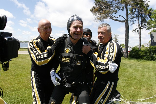 "Former President George H.W. Bush talked about how exhilirating a feeling it was jumping from 10,500 feet with the Army Parachute Team, the Golden Knights. He said ""Get out and do something, get out and enjoy life."" (pictured l-r) SGM Michael Eitnier, 41st President, George H.W. Bush, LTC Anthony Dill, (in the background is SFC Michael Elliott)."