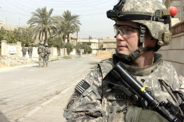 BAGHDAD - Spc. Matthew Collins, of Hinesville, Ga., assigned to the Headquarters and Headquarters Company, 2nd Battalion, 505th Parachute Infantry Regiment, 3rd Brigade Combat Team, 82nd Airborne Division, Multi-National Division-Baghdad, looks back to check his surroundings during Operation Asfah Ramlyah, a combined clearance operation May 28 in the neighborhood of Sumer al-Ghadier, located in the 9 Nissan district of eastern Baghdad. The combined forces teamed up to confiscated several weapons during the operation and disrupt insurgent activity in the region.