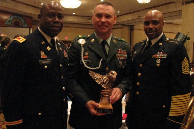 1st Sgt. Terrence Hamil of Bravo Company holds the 1st Sgt. John Ordway award he received at the 234th Army Birthday dinner sponsored by the Redstone-Huntsville Chapter of the Association of the U.S. Army. With Hamil are his commanding officers, at left, Col. Randall Jackson, commander of the 832nd Ordnance Battalion, and Command Sgt. Maj. Willie Pullom of the 832nd. Pullom nominated Hamil for the award, which is presented annually by the local AUSA chapter to an outstanding first sergeant in the active Army, Army Reserves and Alabama Army National Guard.