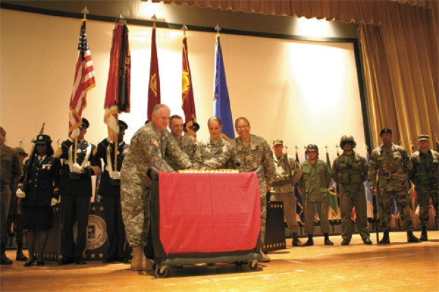 From left, Brig. Gen. Brian Layer, Fort Eustis commander; 1st Lt. James Quillen, Echo Company, 71st Transportation Battalion, 8th Transportation Brigade; Pvt. Crystal Penny, 508th Transportation Company, 71st Trans. Bn., 8th Trans. Bde.; and Command Sgt. Maj. Carolyn Johnson, garrison command sergeant major, cut the Army birthday cake at the conclusion of the Army Streamer Ceremony Friday at Jacobs Theater.