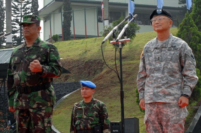 Tentara Nasional Indonesia Ankatan Darat, or Indonesian Army, co-exercise director Gen. Djoko Santoso and U.S. co-exercise director Gen. Vernon Miyagi observe the approximately 1,000 Soldiers and Marines from nine nations during the Exercise Garuda Shield 09 opening ceremony at the TNI-AD Infantry Training Center in Bandung, Indonesia, June 16. The two-week exercise brings together Soldiers and Marines from nine nations to train on UN mandated ground-level tasks. GS09 is the latest in a continuing series of exercises designed to promote regional peace and security. Training will focus on peace support operations and Global Peace Operations Initiative certification, a Command Post Exercise, a Field Training exercise and Humanitarian and Civic Assistance projects.