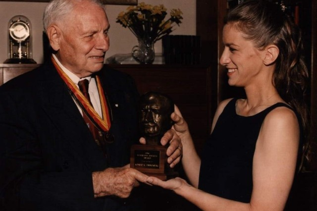 Konrad and Jackie Dannenberg hold up his award from the American Institute of Aeronautics and Astronautics in June 1996.  Konrad, who died in February, received the Hermann Oberth Award that year for his work with the space program.