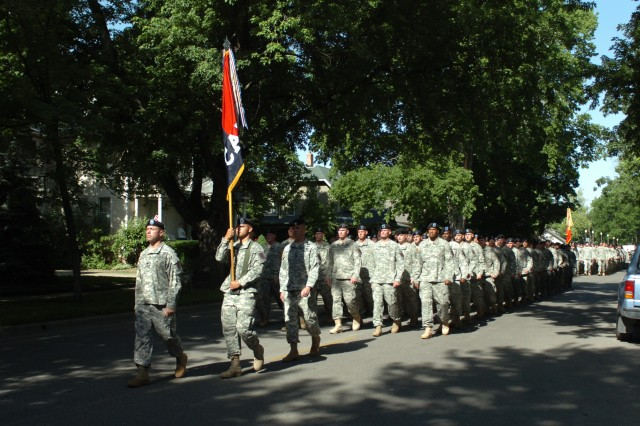 A detachment of Soldiers from the 1st Infantry Division's Combat Aviation Brigade marches down the streets of Abilene, Kan., on the 65th anniversary of D-Day June 6. D-Day bears a special significance to Abilene as then-Gen. Dwight Eisenhower, who was the Supreme Allied Commander during the invasion, is a native of the city.