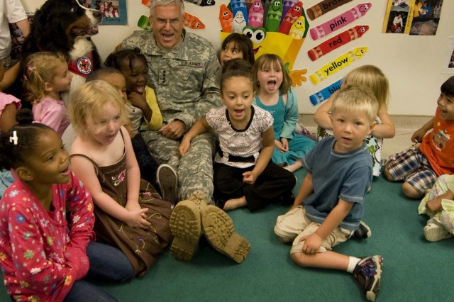 Army Chief of Staff Gen. George W. Casey Jr. celebrates the Army's 234th Birthday with children of Fort Detrick's Forest Glen Annex Child Development Center in Maryland.