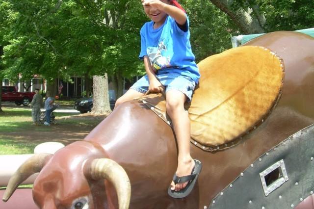 Sean Morgan, 5, rides the bul.. Morgan's father is Sgt. Marces Morgan, U.S. Army Central Command.