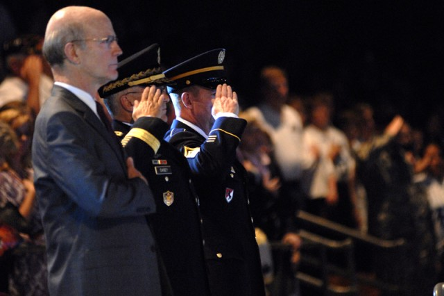 Secretary of the Army Pete Geren, Army Chief of Staff Gen. George W. Casey Jr. and Sgt. Maj. of the Army Kenneth O. Preston listen as the national anthem is sung just prior to the performance of the Army birthday Twilight Tattoo at Fort Myer's Conmy Hall June 17.