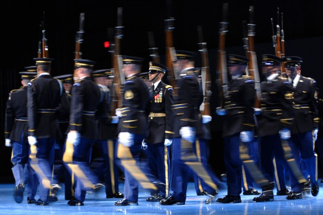 Soldiers from the U.S. Army Drill Team perform at the Army birthday Twilight Tattoo at Fort Myer's Conmy Hall June 17. The drill team uses precision movements and their bayonet-tipped 1903 Springfield rifles to put on an impressive display of