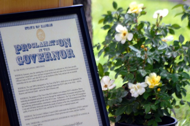 The Kansas governor's proclamation designating 2009 as Year of the NCO rests against the podium near yellow rose bushes about to be planted along the Dragoon Wall by the Sergeant Audie Murphy Club June 12, 2009, at the corner of Kearney and Grant avenues at Fort Leavenworth, Kan.