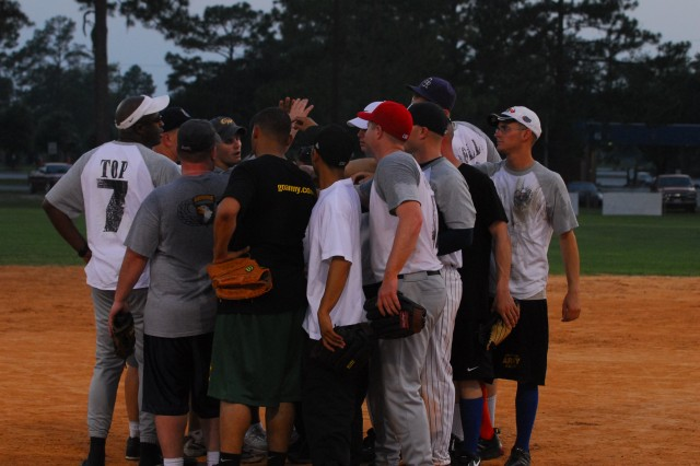 Soldiers from HHC, 4-3 BSTB, rally together after beating the 92nd Engineers, 18-7 at the Fort Stewart Sports Complex, June 9.