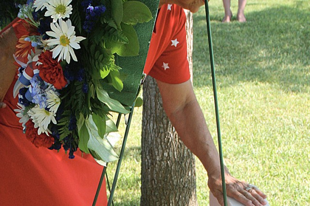 Rita Van Autreve, wife of Sgt. Maj. Leon Van Autreve, is overwhelmed with emotion as she touches her husband's gravestone during a wreath laying ceremony at the Fort Sam Houston National Ceremony June 12, to commemorate the Army's Birthday. Van Autreve was the fourth Sergeant Major of the Army.