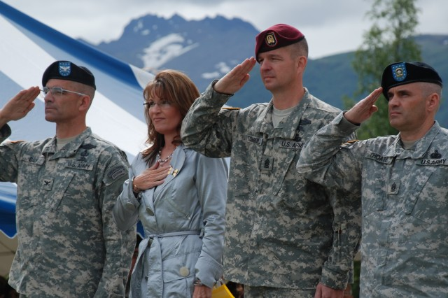 U.S. Army Alaska Deputy Commander Col. Edward Daly, Gov. Sarah Palin, USARAK Command Sgt. Maj. David O. Turnbull and Alaska Army National Guard State Command Sgt. Maj. Gordon Choate salute during the playing of the national anthem at a ceremony proclaiming 2009 as the Year of the Noncommissioned Officer Corps of the United States Army Thursday on Pershing Field at Fort Richardson, Alaska.