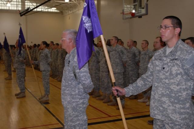 Leaders of seven former chemical companies present their new company guide-ons - bearing the colors and insignia of the civil affairs branch - at a re-flagging ceremony June 19 at Fort Dix, N.J. The companies have been provisionally re-designated as civil affairs units for their upcoming deployments to Iraq. Due to civil affairs units' success in bringing stability to Iraqi regions, the chemical companies were chosen to join the civil affairs mission and build on previous successes. ""