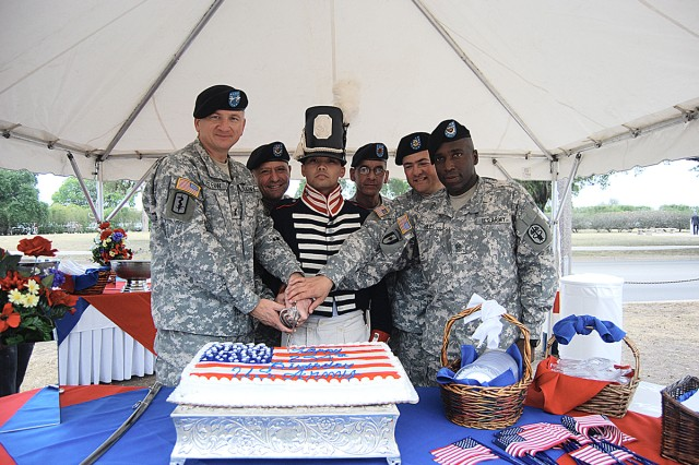 Installation commander, Maj. Gen. Russell Czerw; NCO Academy Commandant Sgt. Maj. Stephen Paskos; Sgt. Roald Riva; Command Sgts. Maj. Pedro Class; Antonio Abin and Howard Riles, cut the Army Birthday cake celebrating the Army's 234th Birthday June 12 and Fort San Houston.