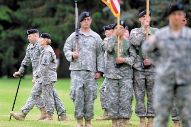 Maj. Gen. Patricia Horoho and Lt. Col. Danny Dudek walk past soldiers from the Warrior Transition Battalion during the Pass in Review portion of a ceremony Wednesday in which Dudek assumed command of the battalion at Fort Lewis.