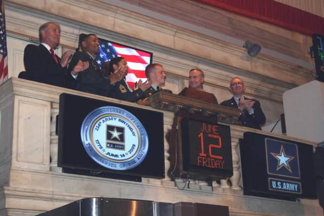 Soldiers and veterans applaud following the closing bell at the New York Stock Exchange June 12. Participants included the 2008 Soldier of the Year, Sgt. David Obray (third from right) and Director of the Army Staff, Lt. Gen. David H. Huntoon Jr. (second from right). The closing bell was in commemoration of the U.S. Army's 234th Birthday and Flag Day, which was June 14.